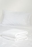 White towels on bed Stock Photography