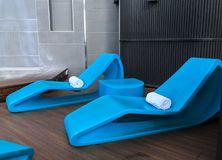 White Towels on Blue Plastic Chaise Lounges. On Deck royalty free stock photo