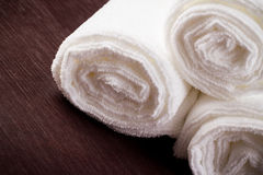 White towels on brown background Stock Photography
