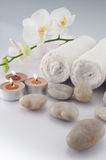 White towels and candles. White towels and orchid, candles on white bacground stock image