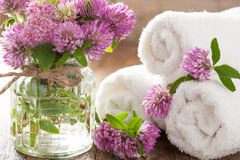 White towels and clover flowers Royalty Free Stock Photo
