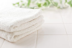 White towels and green on white tile Stock Photography