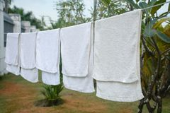 white towels hanging on the line Stock Photo