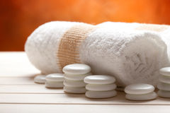 White towels and massage stones Stock Photography