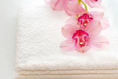 White towels with an orchid royalty free stock images