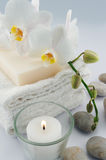 White towels and orchid, candle. White towels and soap, orchid, candle on white bacground royalty free stock photography