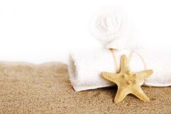 White towels and seastar Royalty Free Stock Photos