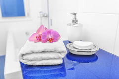 White towels and soap in the bathroom. Stock Photos