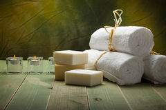 White towels, soap and candle Stock Photos