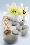White towels and stones. Orchid, bamboo on white bacground stock images