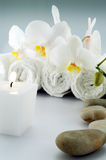 White towels and stones with soap. White towels and soap, orchid, on white bacground royalty free stock photo