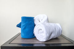White towels on wood table in bathroon Royalty Free Stock Photos