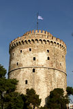 White tower. And the greek flag, Thessaloniki, Greece royalty free stock photography
