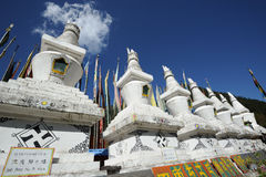 White tower  and  prayer flags(Jingfan) Stock Image