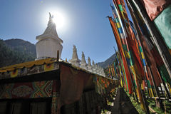 White tower  and  prayer flags(Jingfan) Royalty Free Stock Photography