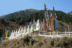 White tower  and  prayer flags(Jingfan) Royalty Free Stock Photos