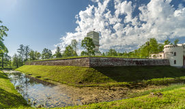 White tower with rampart and graff. In spring, Aleksandrjvsky park, Pushkin, Russia Stock Image