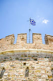 White tower in Thessaloniki. And Blue background and greek flag Royalty Free Stock Images
