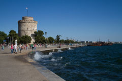 White Tower of Thessaloniki. Tourists strolling on the seafront city of Thessaloniki in the summer of 2014 royalty free stock image