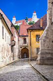 White towers of Bratislava castle. Contrast of old town buidlings with nice white castle in the background. Historic part of Bratislava city, Slovakia royalty free stock image