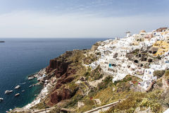 The white town of Oia on the cliff overlooking the sea, Santorini, The Cyclades, Greece Royalty Free Stock Photography