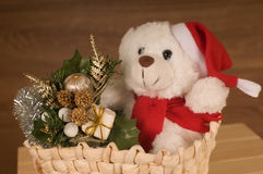 White toy bear in basket. With Christmas decoration royalty free stock photography