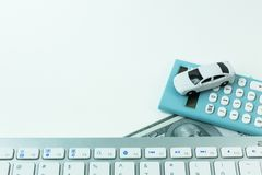 The white toy car and keyboard computer close up image background. White toy car and keyboard computer close up image background royalty free stock photo