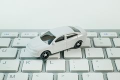 The white toy car on keyboard computer close up image background. White toy car on keyboard computer close up image background royalty free stock images