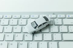 The white toy car on keyboard computer close up image background. White toy car on keyboard computer close up image background stock images
