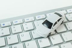 The white toy car on keyboard computer close up image background. White toy car on keyboard computer close up image background stock photos