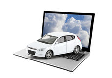 White toy car on laptop Stock Images