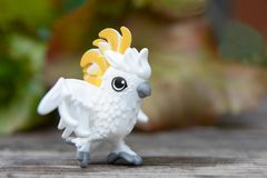 White toy parrot with yellow crest royalty free stock images