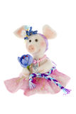 White toy pig in a pink skirt. A White toy pig in a pink skirt r Stock Photos