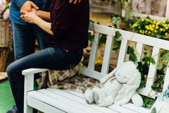 White toy rabbit lies on  bench Royalty Free Stock Images