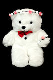 White toy teddy bear present for a child. Black background. Child present white teddy bear on black background stock photos