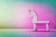 White toy unicorn on wooden floor of kids room with empty rainbow concrete wall background in startup business success concept.
