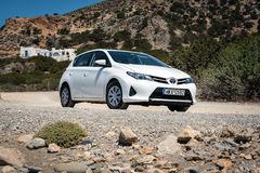 White Toyota Auris stays parked on road of Crete island. Stock Images