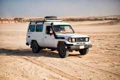 White toyota car driving in desert of Hurghada, Egypt Royalty Free Stock Images
