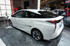 White Toyota Prius. Photo of 2016 white toyota prius at the washington dc auto show on 1/28/16.  The new prius features improved styling, handling and fuel Royalty Free Stock Images