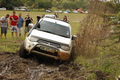 White Toyota Triton DHD crossing mud obstacle Royalty Free Stock Images