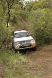White Toyota Triton DHD crossing mud obstacle Royalty Free Stock Photos