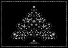 White tracery Christmas tree with snowflakes and beads Royalty Free Stock Image