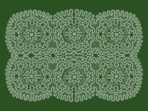 White tracery. On the green background Royalty Free Stock Photo