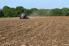 White Tractor Tilling Field Stock Photography