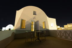 White traditional greek villa terrace under night stars. Beautiful white villa found in the greek islands under the stars of the night sky royalty free stock photography