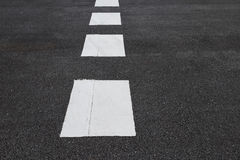 White traffic lines marking on asphalt road Royalty Free Stock Photography