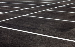 White traffic markings on a asphalt parking lot Royalty Free Stock Photos