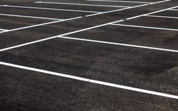 White traffic markings on a asphalt parking lot Royalty Free Stock Photos