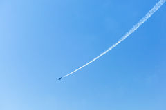 White trail of a jet fighter Royalty Free Stock Image