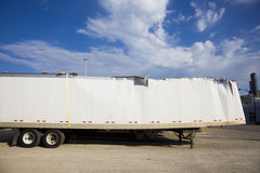 White trailer after accident against blue sky. Royalty Free Stock Photography